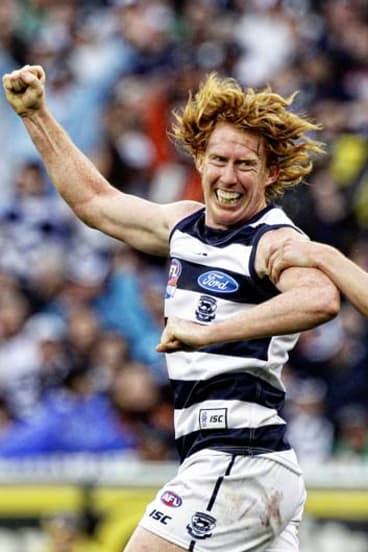 That premiership feeling... then Cats captain Cameron Ling celebrates a goal in the final quarter of the 2011 grand final.