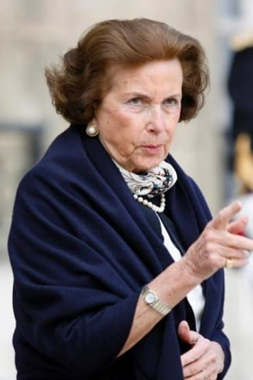 Liliane Bettencourt leaves the presidential Elysee Palace in Paris in 2007. Mr Sarkozy was cleared last year of claims he took the heiress' money when she was too frail to comprehend.