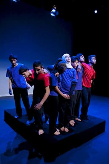 Cast members performing <em>Tree of Life</em>, which incorporates refugee students' stories.