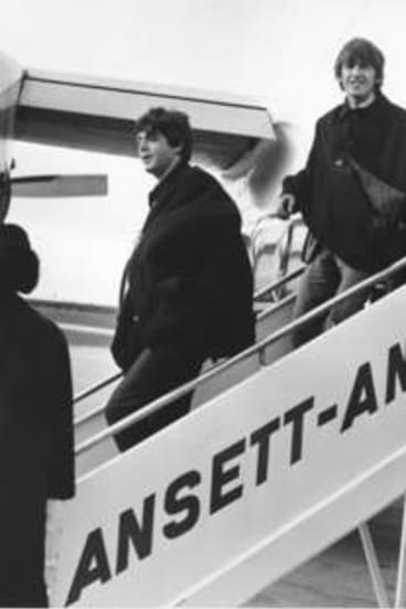 The Beatles arrive at Essendon Airport, Melbourne.