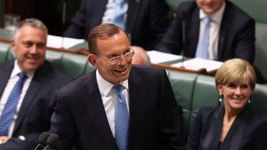 """Prime Minister Tony Abbott smiles at the press gallery after he withdraws his description of   Opposition leader Bill Shorten as """"the Dr Goebbels of economic policy"""" during question time  on Thursday."""