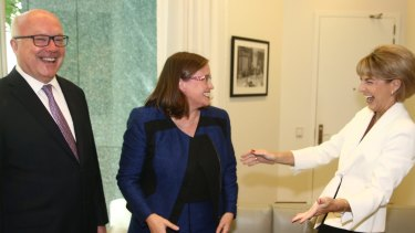 Minister for Women Michaelia Cash congratulates Kate Jenkins on her announcement as the new Sex Discrimination Commissioner with Attorney-General George Brandis at Parliament House on Thursday.