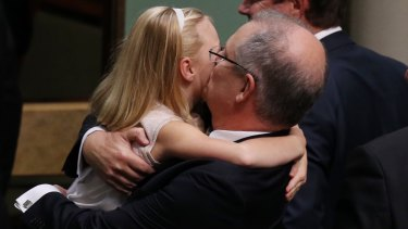 Treasurer Scott Morrison is hugged by his daughter after he gave the budget address on Tuesday.