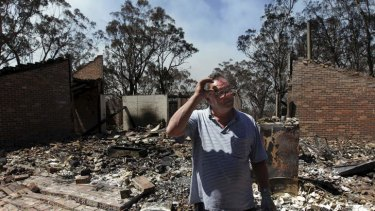 Photograph shows Laurie Eades standing in the ruins of his Mt Victoria home, which was raised in Thursday's firestorm. Laurie was a collector of antique artefacts and was able to salvage some Byzantine coins, silver earrings and an ancient Greek jug.
