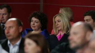 Therese Rein and Jessica watch the community forum at Rooty Hill RSL in Sydney on Wednesday.