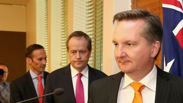 Shadow assistant treasurer, Andrew Leigh, Opposition Leader Bill Shorten and shadow treasurer Chris Bowen address the media at Parliament House on Monday.