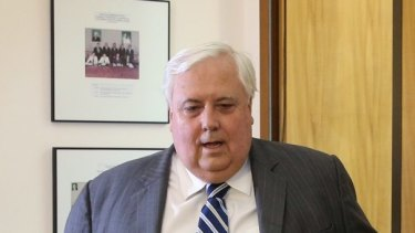 Clive Palmer makes a statement to the media at Parliament House in Canberra on Tuesday.