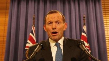Opposition Leader Tony Abbott addresses the media late on Wednesday night.