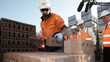 Coalition leader Tony Abbott tours a brickworks in Longford, Tasmania, on Tuesday.