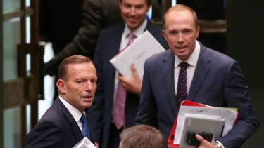 Prime Minister Tony Abbott and Immigration Minister Peter Dutton leave question time on Tuesday.