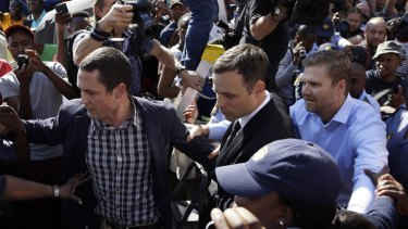 Oscar Pistorius leaves court at the end of the day.
