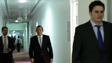 Opposition Leader Tony Abbott visits the press gallery after his press conference at Parliament House on Sunday.