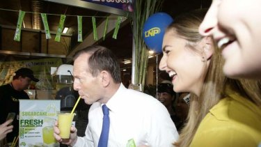 Opposition leader Tony Abbott and his daughters visit the Ekka during his visit to Brisbane on Friday.