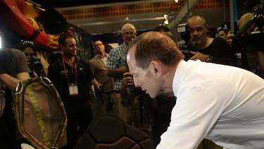 Opposition leader Tony Abbott visits the Australian Fishing Trade Show on the  Gold Coast, Queensland, on Monday.