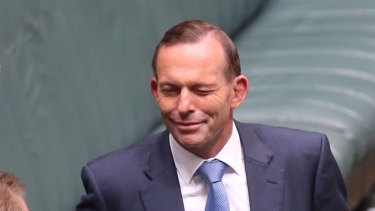 Prime Minister Tony Abbott winks at the conclusion of question time on Thursday.
