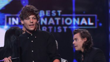 One Direction accepts the ARIA for best international act.
