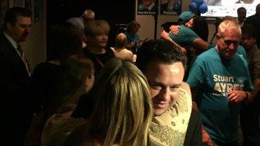 Stuart Ayres hugs federal MP Fiona Scott at his victory party.