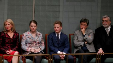 Opposition Leader Bill Shorten's wife Chloe and children Georgette and Rupert listen as he delivers the budget reply speech.