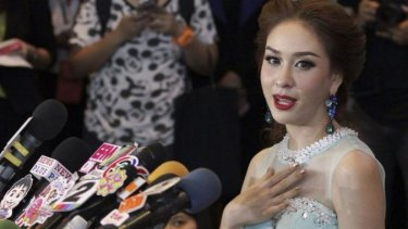 Outspoken ... Weluree Ditsayabut, 22, announces she is relinquishing her title as Miss Universe Thailand during a news conference at the Renaissance Hotel in Bangkok.
