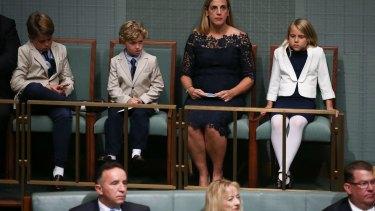 The Treasurer's family Xavier Hockey, Ignatius Hockey, Melissa Babbage and Adelaide Hockey listen to the budget reply speech in Parliament on Tuesday.