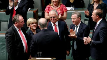 Treasurer Scott Morrison is congratulated by his colleagues after he delivered the budget speech on Tuesday.