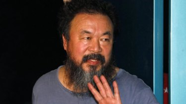 Dissident Chinese artist Ai Weiwei speaks to the media after being released on bail in Beijing.