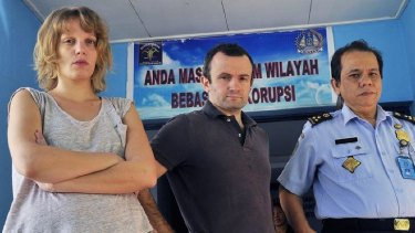 French journalists Thomas Dandois (centre), 40, and Valentine Bourrat (left), 29, from Franco-German television channel Arte are photographed with an unidentified Indonesian immigration official in Jayapura city in Papua province.