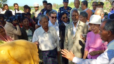 Former UN secretary-general Kofi Annan, third from right, speaks to Rohingya villagers during a visit to Rakhine state in December.