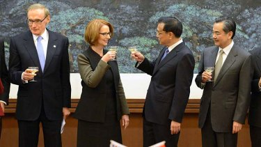 Australia's Prime Minister Julia Gillard shares a toast with Chinese Premier Li Keqiang during a signing ceremony at the Great Hall of the People in Beijing.