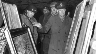 General Dwight D. Eisenhower, center, inspects paintings in a salt mine at Merkers, Germany, where the Nazi government stored art treasures plundered in occupied countries in this April 12, 1945 file photo.