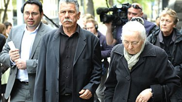 The Helvagis family leaves court today.