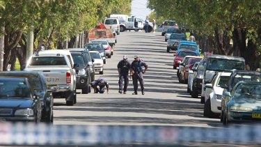 Gunned down: Police investigate the Wilbur Street shooting.