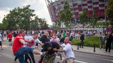 Fight ... Polish and Russian football fans clash.