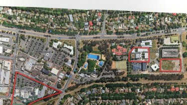 Land owned by Tradies in Dickson shops including the carpark the club bought from the government, at left, and the two blocks behind the pool which the government bought from the Tradies, including the CFMEU headquarters.