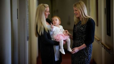 Dr Clare Whitehead (right) with Rochelle Haralambous and her baby Tia.