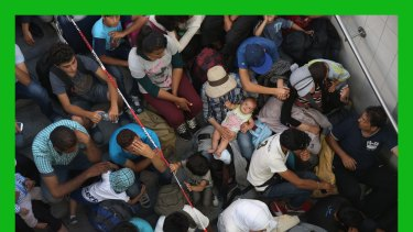 Migrants who arrived on a train from Budapest wait to be registered by the German police in Rosenheim.
