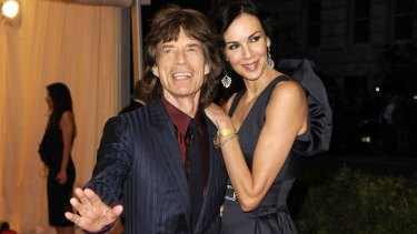 The Rolling Stones singer Mick Jagger, left, and girlfriend L'Wren Scott in 2012.
