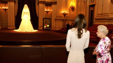 """Horrid"" ... Kate Middleton and the Queen view the wedding dress display."