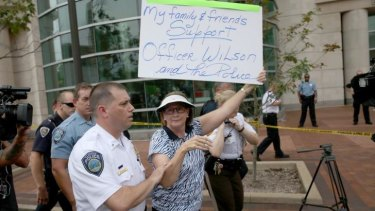 Patty Canter supporting Darren Wilson and police at the St Louis Justice Centre.