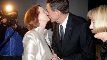 No problem ... Prime Minister Julia Gillard greets Air Chief Marshall Angus Houston.