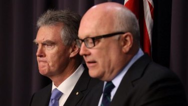 """Duncan Lewis, the new ASIO chief, was introduced by Senator Brandis on Monday when the minister announced he would explicitly rule out """"torture"""" under new national security legislation."""