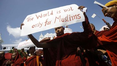 Widespread unrest ... a Myanmar Buddhist monk  takes part in a demonstration against the Organisation of the Islamic Conference in Yangon, Burma.