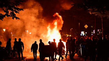 "Protesters erect burning barricades during the ""Welcome to Hell"" protest march in Hamburg."
