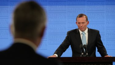 Prime Minister Tony Abbott takes a question from Channel 7's Mark Riley as he addresses the National Press Club.