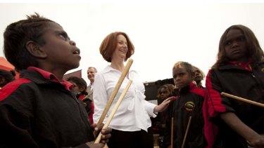 Julia Gillard with members of the Alice Springs childrens drumming group, Drum Atweme.