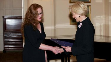 Dianna Nixon, left, receiving a Churchill Fellowship from Governor-General Quentin Bryce.