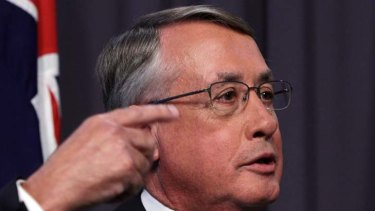 For my next trick … the Treasurer, Wayne Swan, yesterday, who faces an uphill battle to bring the budget back into the black.