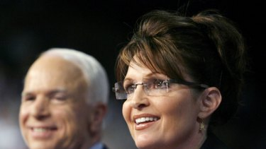 US Republican presidential candidate Senator John McCain looks on as his vice presidential running mate Alaska Governor Sarah Palin speaks at a campaign event in Dayton, Ohio,