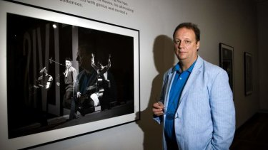 BEFORE THE KING WAS CROWNED: Smithsonian National Portrait Gallery researcher Warren Perry with one of the portraits from Elvis at 21.