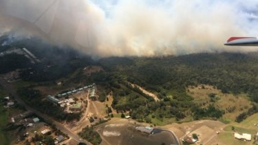 Firefighters were working to combat a blaze that breached containment lines at Williamtown, just north of Newcastle.